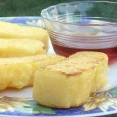 Fried Cornmeal Mush.  This was a mainstay for breakfast at my Grandparent's when I was kid.  Really wonderful.