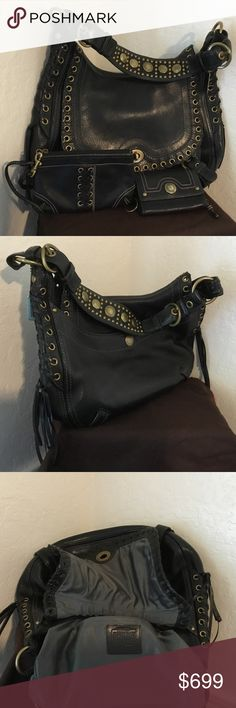 """Coach Limited Edition SUPER RARE Abbey Satchel SET This is a UNBELIEVABLE Coach Black Vachetta Leather Limited Edition Studded Large Chelsea Abbey Lace, Grommet Satchel, Wristlet and Wallet SET!!! It is Pebbled Leather with Brass Finishings,buckles and grommets.There is Lacing Detailing on both sides.This is a very comfortable fitting shoulder bag. NOTE* This is a heavy high quality bag. It is part of the """"Distressed Coach Line."""" If this is not your taste or style please consider this…"""