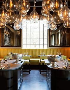LaV in Austin Channels Rustic French Decor and Cuisine xo yellow banquette