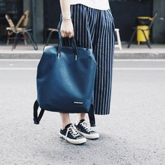 @pamhomme wearing Shoes Like Pottery sneakers and carrying a Freitag PETE bag.