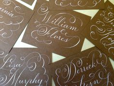 Letters By Anat wedding calligraphy. White ink on brown paper place cards
