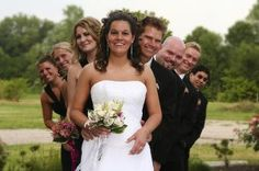 PARTY BEHIND BRIDE AND GROOM WITH HEADS OUT