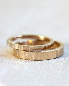 Solid 14k gold tree bark wedding ring set. Wood grain pattern adorns both wedding rings in this unique solid 14k gold band ring set. The wider ring measures about 4mm wide and 2mm thick and the narrow