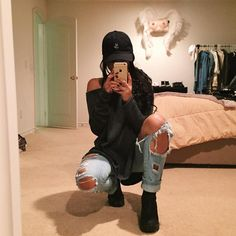 (Cold & 50/50) Girly Tomboy // Black hat, Black Baggy Sweater, Loose Distressed Jeans, Black Timberlands  Hair: side ponytail, bun, OR out/down