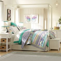 From the bed set to the lamp to the wall hanging, the purple, turquoise and blue make perfect accents to offset the white.  Also like the wall paneling.