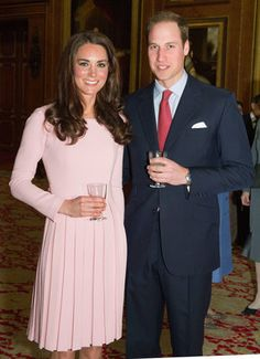 Kate Middleton, Duchess of Cambridge, with Prince William on May 18. Photo by Getty Images