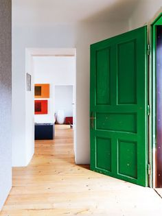 Love the color block effect looking down the hall.  Via A Delightful Design: green front door: The Cottage Project