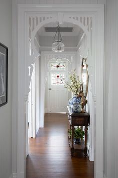 An old Queenslander home in Red Hill is given a designer renovation by Gatti Design to restore its innate charm and bring it into the now. House, Home, Entry Hallway, Hamptons House, House Interior, Architrave, Hallway Designs, Renovations, House And Home Magazine