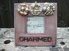Silver charm  frame by AgoVintage on Etsy, $24.50