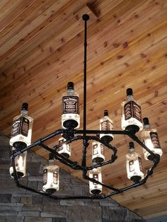 Custom made Jack Daniels chandelier! Garage, ideas, man cave, workshop, organization, organize, home, house, indoor, storage, woodwork, design, tool, mechanic, auto, shelving, car.