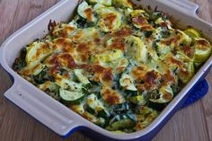 Easy Cheesy Zucchini Bake found on KalynsKitchen.com. I love this with 6 cubes of frozen basil and sliced leeks instead of onion.