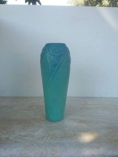 Check out this item in my Etsy shop https://www.etsy.com/listing/531839326/van-briggle-blue-daffodil-vase-art