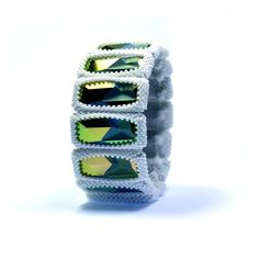 This striking bracelet makes use of some unusual crystals (designed by Jean Paul Gaultier for Swarovski).