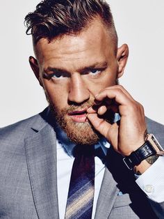 Photographed by Eric Ray Davidson for The Wall Street Journal, Conor McGregor is dashing in a grey suit.