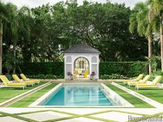 Bright Yellow: In the pool area of a Naples, Florida, house, chaises sit with buttercup-yellow Sunbrella cushions.