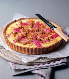 Crust: sweet short pastry, cover with pieces of rhubarb, mix 1 can of sweetened condensed milk with 2 eggs and 50 grams of flour, pour over the rhubarb and bake for 30-40 minutes at 220 celcius.