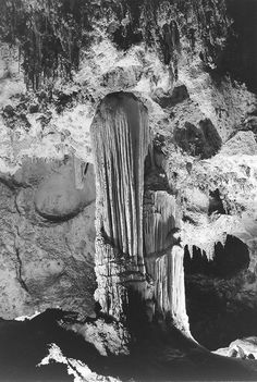"CARLSBAD CAVERNS NATIONAL PARK, NEW MEXICO ""Formations above Green Lake, Large stalagmite with draped stalactite above it. One of the principal features in the King's Palace."""
