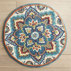 Well, this is unexpected—an artistic medley of florals and a suggestion of the sun in an elegant round rug. Boldly bright and extremely soft, our rug deserves to be both admired and enjoyed. Consider your entryway or family room its gallery.
