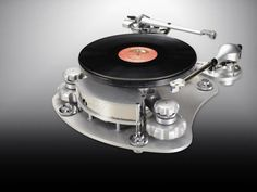 """EAR Disc Master Magnetic Turntable, designed by Tim de Paravicini I think definitely qualifies as a """"modern"""" turntable. From NeedleDoctor: """"The Disc Master uses an arrangement of opposing magnets to drive the platter, virtually eliminating any motor noise from the record/stylus interface. With no belt between the platter and the motor, there is no way for vibrations to travel through to the stylus."""""""