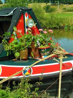 Flowers grow on a colourful barge, Great Heywood, Staffordshire, England