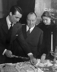 Cary Grant, Alfred Hitchcock and Ingrid Bergman celebrate Cary Grant's birthday on the set of Notorious, 1946
