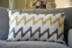 hand painted tribal zig zag pillow in red, brown and olive, chevron, hippie, southwestern, african, native american, navajo, cherokee. $44.00, via Etsy.