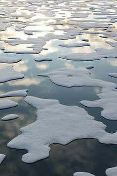 Ice with reflected clouds.