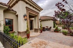 Mediterranean Exterior of Home with Pathway, Fence, Fire pit, exterior stone floors, exterior brick floors
