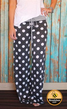 """Cold weather is here and that means sitting by the fire in comfy lounge pants with a good book or movie. We love our new Polka Dot Lounge Pants for lounging around the house or wearing to bed! These feature an AMAZINGLY soft French Terry fabric and come with a high-waisted drawstring band. You will love the extra long length (Inseam is 31"""") and the adorable polka dot details to keep you cute and comfy at the same time!Made of 60% Cotton, 35% Polyester, 5% SpandexSmall (0-4)Medium (4-8)Large…"""