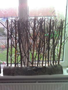 Raamschot van boomtakken en boomstam