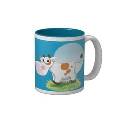 Cute Cow Cartoon Mug - cow on a tuft of grass with a blue moon behind her.