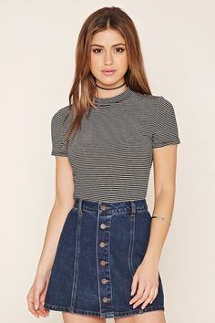 This shimmery striped top features a high neckline, short sleeves, and a cropped length. #nowtrending