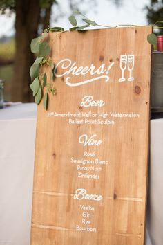 Wooden rustic wedding drink menu: Invitations: bride DIY - http:// Event Planning: Lovely Day Events - http://www.stylemepretty.com/portfolio/lovely-day-events Photography: Suzanne Karp Photography - www.suzannekarp.com Read More on SMP: http://www.stylemepretty.com/california-weddings/2017/03/27/wine-country-wedding-with-personal-details/