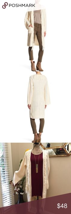 Boutique BOHO tassled hippie chic sweater cardi Boutique BOHO tassled hippie chic sweater cardigan. This is a super soft heavier knit stunning cardi that's perfect for fall to winter layering. This is a cream color with tassels in the collar, the pock