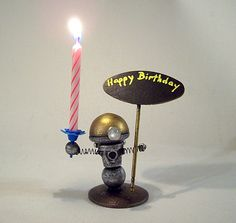 Robot Birthday Cake Candle and by buildersstudio.deviantart.com