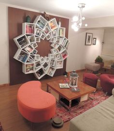 book shelf out of square boxes arranged in a circle. 3 different sizes.
