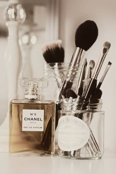Clear glass jars to hold makeup brushes on your dressing table.