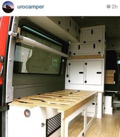 Camper RV pull-out bench that turns into bed, with hammock style bunk bed above (stowed out of way).  Designed for 4x4 Sprinter conversion, by Urocamper