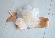 Feather Wristlet Corsage Unique and romantic. One Beautiful Feathers elegant Wristlet Corsage Inspired 1920s , Great Gatsby Style will definitely catch everyones eye ! Made of ostrich and peacock feathers embellishment with rhinestone piece. This wristlet corsage is perfect for weddings,special events, proms, quinceaneras, mothers day, photoshoot. It can be made with ribbons to tie on. Vintage inspired - stylish with modern look. For any questions please mail me, ill be very happy to help…