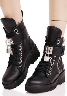 Current Mood Lock 'N Key Boots have gotcha for LYFE, babe. These tried 'N true combat BBz feature a vegan leather construction, supa lightweight treaded platform sole, oversized eyelet lace-ups, adjustable wraparound velcro strap, sikk functional Current Mood branded lock hardware latched to the front, padded tongue, and exposed outer zip closures. #dollskill #currentmood #newarrivals #platforms #heels #newshoes