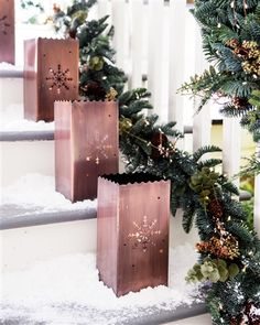 These Balsam Hill Snowflake Metal Luminaries have a rustic charm that will light up any indoor or outdoor space.