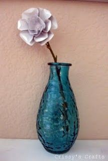 Metal flowers made from pop cans.  I absolutely LOVE these.  Can't wait to make them.