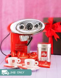 Buy or Send if you know someone or are someone who loves coffee then this is just for you, this includes two branded Illy Espresso cups accompanied with a red Illy Coffee machine, a 125g tin of Hypo Coffee capsules and a box of Cote Dor Mignonettes chocolates in South Africa. | Item Code RA1899