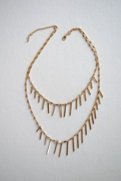 Gold plated delicate chain with two layers of dagger like fringe. Free shipping