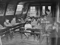 February 1936: Schoolchildren having lessons on a barge at West Drayton.