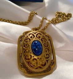 Avon Yesteryear gold locket with lapis blue stone by Ladysprettys, $14.99