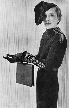 Elsa Schiaparelli Ensemble, 1935 - wearing one of her famous avant garde hats.