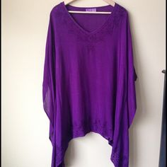 Purple one size kaftan blouse This beautiful purple oversized blouse was purchased by a fellow Vintie but did not agree with my skin color. It is a one size but can fit up to a 2X just fine. It is not damaged in any ways and still in very good condition. It is very comfortable and oversized in a great way!!!!!  I am open to offers and I discount bundles as well! Let me know if you have any questions! Tops Tunics