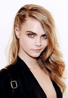 cara delevingne // deep side-part hair with braid