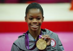 Gold medallist Gabrielle Douglas of the U.S. stands on the podium after the women's individual all-around gymnastics final in the North Greenwich Arena at the London 2012 Olympic Games August 2, 2012.